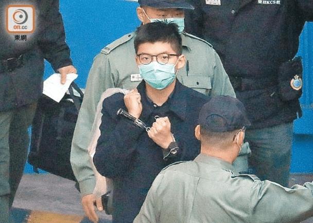 港媒:消息称港警今日会拘捕正被收押的乱港分子黄之锋、谭得志